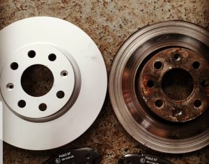 A nice, new shiny brake disc compared to an old one.