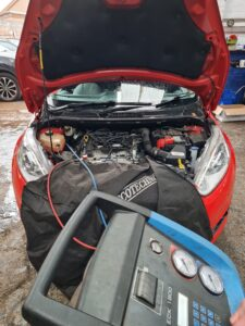 An air con service in action on this Ford Fiesta.